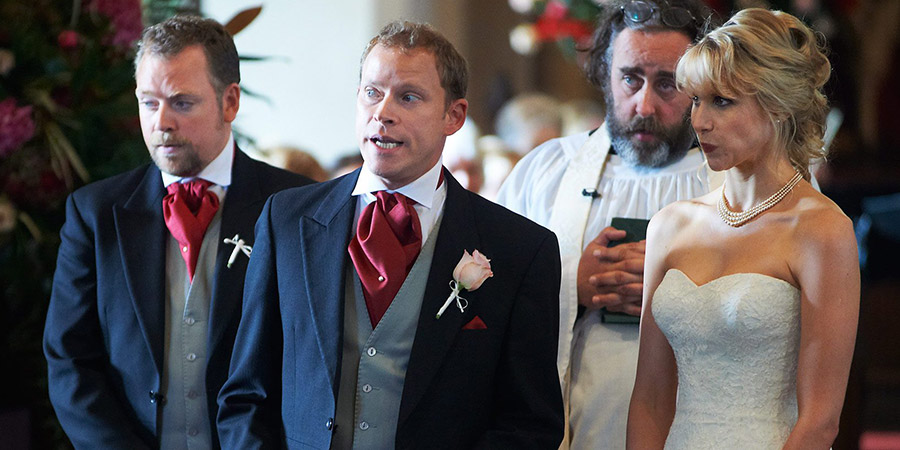 The Wedding Video. Image shows from L to R: Raif (Rufus Hound), Tim (Robert Webb), Reverend Dobbs (Angus Barnett), Saskia (Lucy Punch). Copyright: Timeless Films.