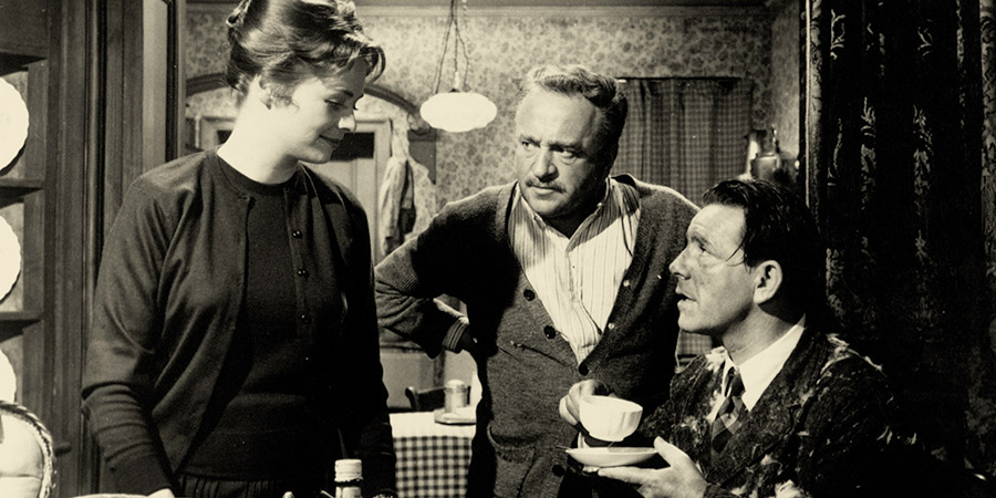 There Was A Crooked Man. Image shows from L to R: Ellen Foster (Susannah York), Foster, Station Master (Reginald Beckwith), Davy Cooper (Norman Wisdom).