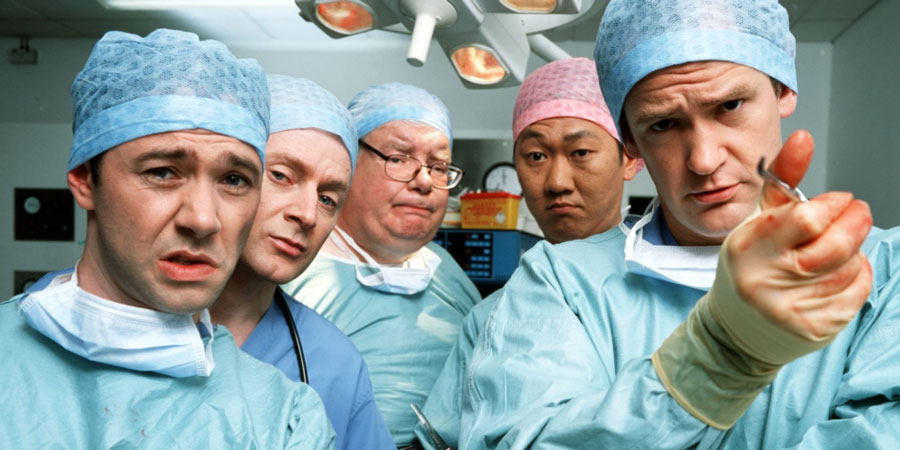 TLC. Image shows from L to R: Dr. Laurence Flynn (Reece Shearsmith), Gasman (Erich Redman), Mr. Benedict Ron (Richard Griffiths), Terry Cheung (Benedict Wong), Dr. Stephen Noble (Alexander Armstrong).