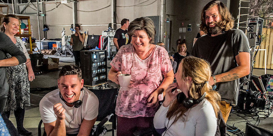 Behind-the-scenes on the Two Doors Down set. Image shows from L to R: Unknown, Simon Carlyle, Christine (Elaine C. Smith), Unknown, Unknown. Copyright: BBC Studios.