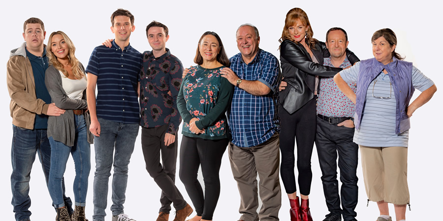 Two Doors Down. Image shows from L to R: Alan (Graeme Stevely), Michelle (Joy McAvoy), Gordon (Kieran Hodgson), Ian (Jamie Quinn), Beth (Arabella Weir), Eric (Alex Norton), Cathy (Doon Mackichan), Colin (Jonathan Watson), Christine (Elaine C. Smith). Copyright: BBC.