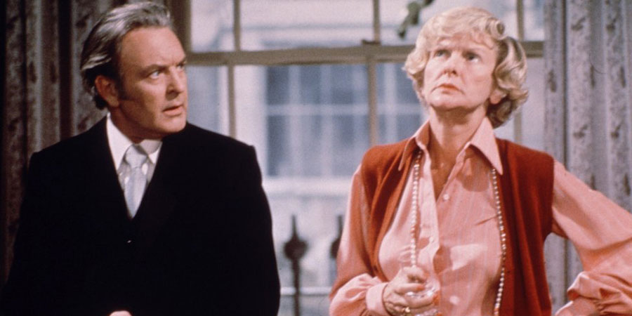 Two's Company. Image shows from L to R: Robert Hiller (Donald Sinden), Dorothy McNab (Elaine Stritch). Copyright: London Weekend Television.