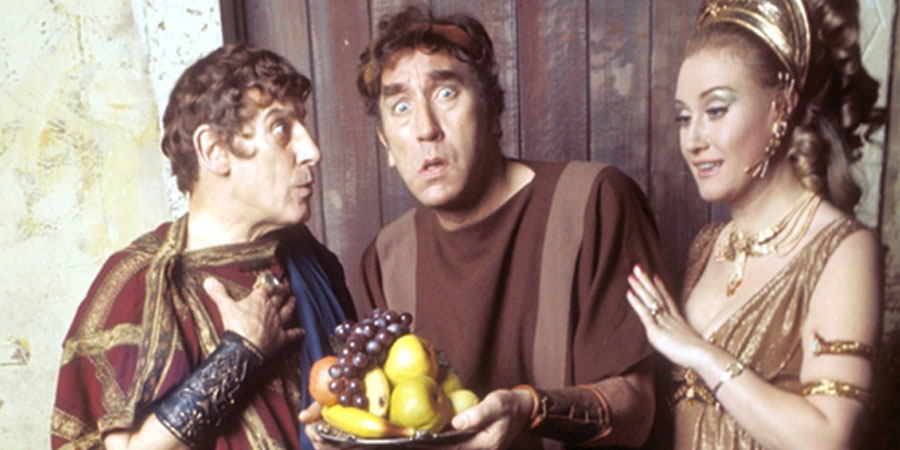 Up Pompeii!. Image shows from L to R: Ludicrus Sextus (Wallas Eaton), Lurcio (Frankie Howerd), Ammonia (Elizabeth Larner). Copyright: BBC / London Weekend Television.