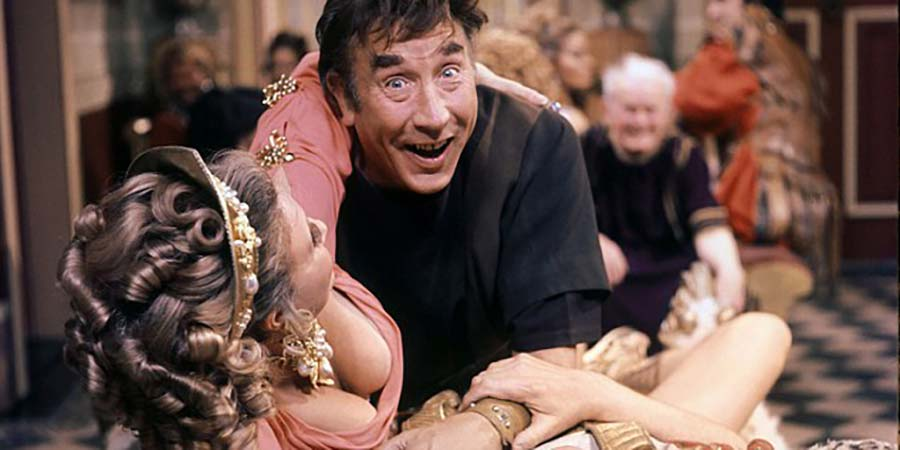 Up Pompeii. Image shows from L to R: Ammonia (Barbara Murray), Lurcio (Frankie Howerd), Ludicrus Sextus (Michael Hordern). Copyright: Associated London Films Limited.