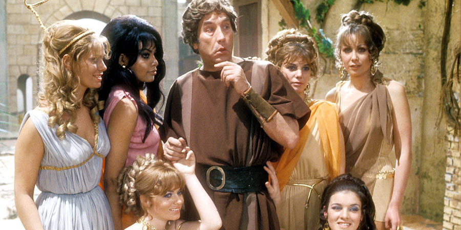 Up Pompeii!. Image shows from L to R: Unknown, Unknown, Unknown, Lurcio (Frankie Howerd), Unknown, Unknown, Unknown. Copyright: BBC.
