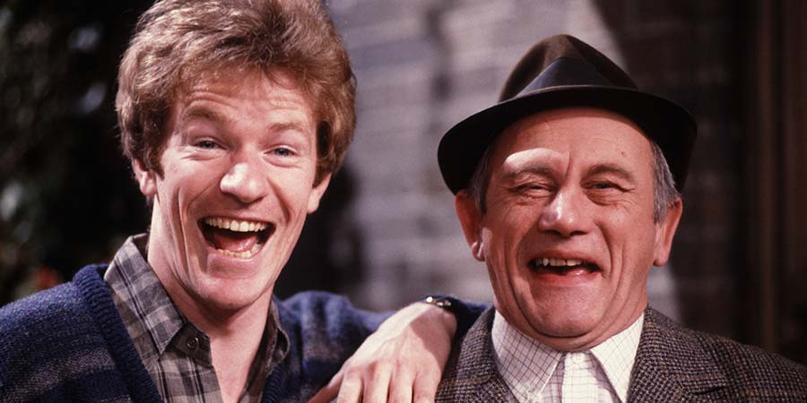 Up The Elephant And Round The Castle. Image shows from L to R: Jim London (Jim Davidson), Dad (John Bardon). Copyright: Thames Television.