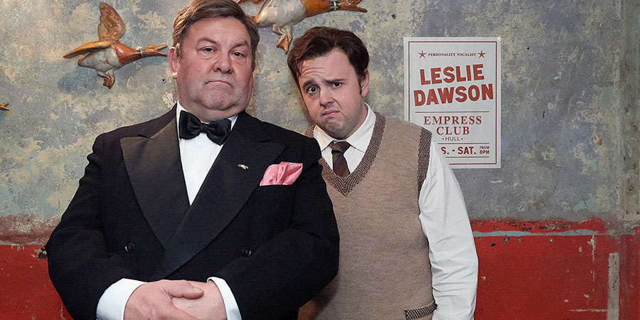 Urban Myths: Les Dawson's Parisienne Adventure. Image shows from L to R: Older Les (Mark Addy), Young Les (John Bradley). Copyright: Red Production Company.