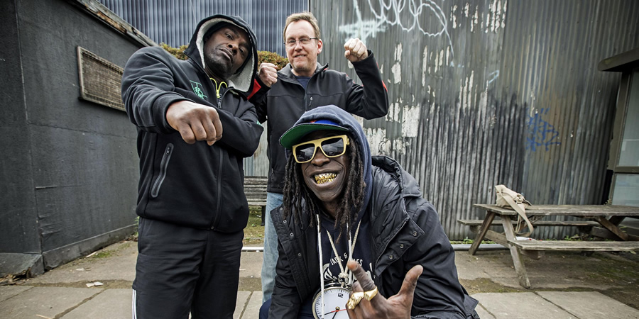 Urban Myths: Public Enemy (feat. Kev Wells). Image shows from L to R: Chuck D (Paterson Joseph), Kev Wells (Philip Glenister), Flavor Flav (Abdul Salis).