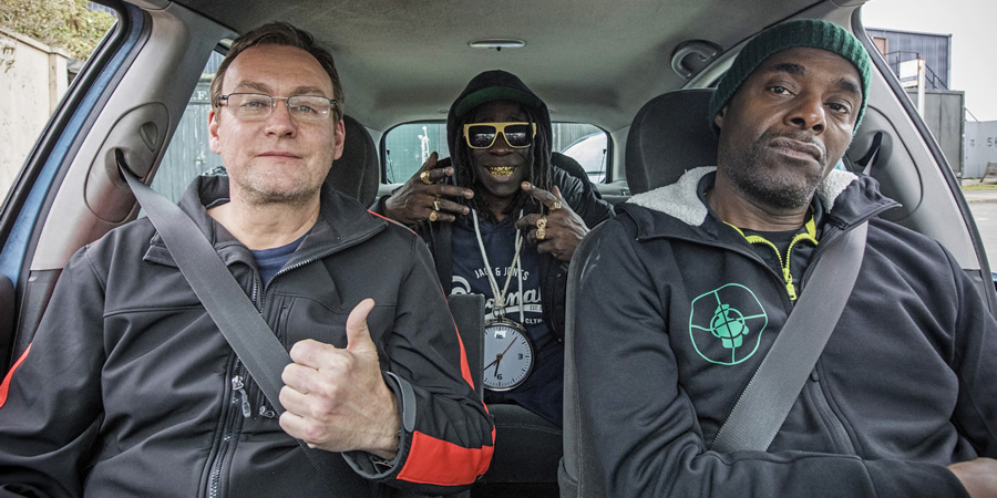 Urban Myths: Public Enemy (feat. Kev Wells). Image shows from L to R: Kev Wells (Philip Glenister), Flavor Flav (Abdul Salis), Chuck D (Paterson Joseph). Copyright: Happy Tramp Productions.