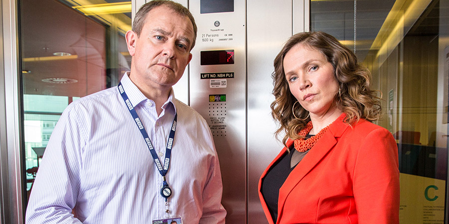 W1A. Image shows from L to R: Ian Fletcher (Hugh Bonneville), Siobhan Sharpe (Jessica Hynes). Copyright: BBC.