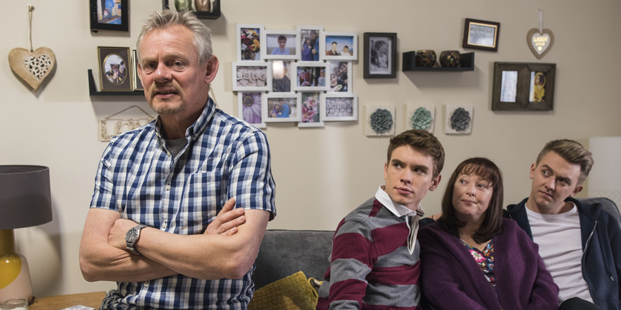 Warren. Image shows from L to R: Warren Thompson (Martin Clunes), Danny (Oscar Morgan), Anne (Lisa Millett), Charlie (Tim Preston). Copyright: Hat Trick Productions.