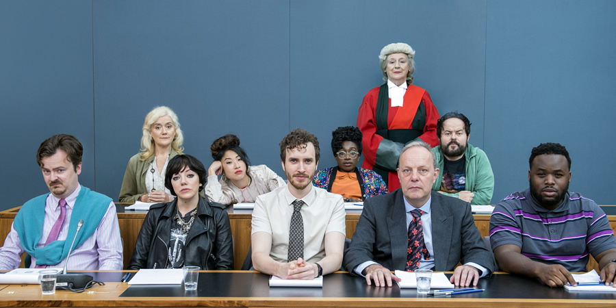 We The Jury. Image shows from L to R: Lucas (Oliver Maltman), Jen 1 (Sophie Thompson), Olivia (Diane Morgan), Sam (Kae Alexander), William (Edward Easton), Wolf (Vivienne Acheampong), Judge Henman (Maggie Steed), Mr Martin (David Schaal), Hugh (Kenneth Collard), Don (Samson Kayo). Copyright: Big Talk Productions.