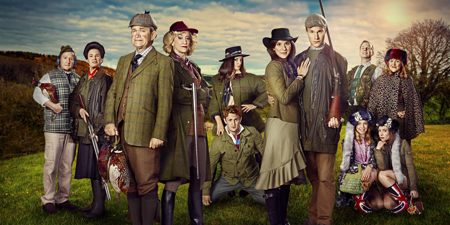 The Windsors. Image shows from L to R: Edward (Matthew Cottle), Princess Anne (Vicki Pepperdine), Charles (Harry Enfield), Camilla (Haydn Gwynne), Pippa (Morgana Robinson), Harry (Richard Goulding), Kate (Louise Ford), Wills (Hugh Skinner), Andrew (Tim Wallers), Beatrice (Ellie White), Eugenie (Celeste Dring), Fergie (Katy Wix). Copyright: Noho Film and TV.
