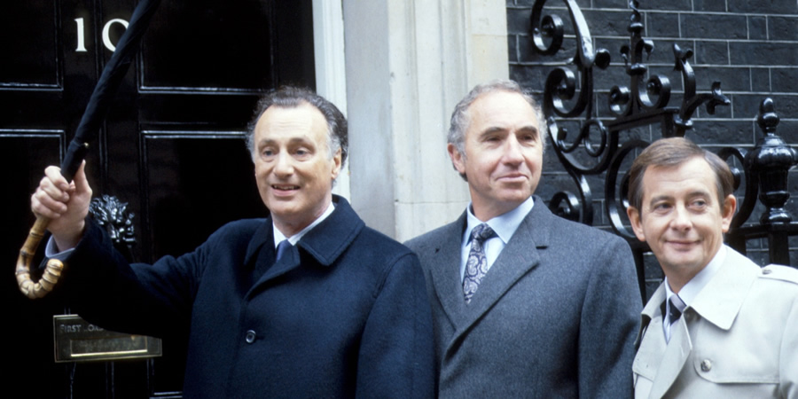 Yes, Prime Minister. Image shows from L to R: James Hacker (Paul Eddington), Sir Humphrey Appleby (Nigel Hawthorne), Bernard Woolley (Derek Fowlds).