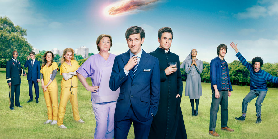 You, Me And The Apocalypse. Image shows from L to R: General Gaines (Paterson Joseph), Scotty (Kyle Soller), Rhonda (Jenna Fischer), Leanne (Megan Mullally), Paula (Pauline Quirke), Jamie (Mathew Baynton), Father Jude (Rob Lowe), Sister Celine (Gaia Scodellaro), Ariel (Mathew Baynton), Dave (Joel Fry). Copyright: Working Title Films / Bigballs Films.
