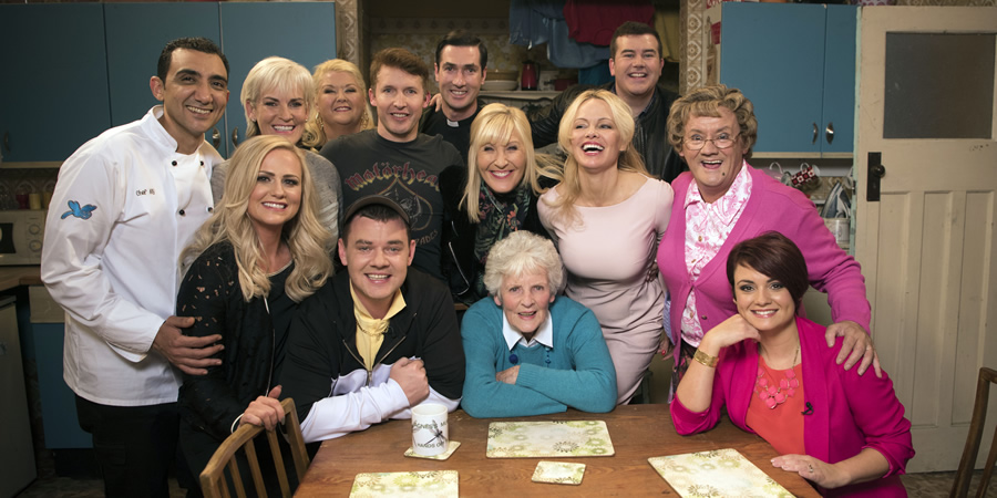 All Round To Mrs. Brown's. Image shows from L to R: Aly Mahmoud, Betty Brown (Amanda Woods), Judy Murray, Sharon McGoogan (Fiona Gibney), Buster Brady (Danny O'Carroll), James Blunt, Father Damien (Conor Moloney), Cathy Brown (Jennifer Gibney), Shirley Erskine, Pamela Anderson, Dermot Brown (Paddy Houlihan), Mrs Brown (Brendan O'Carroll), Maria Brown (Fiona O'Carroll).