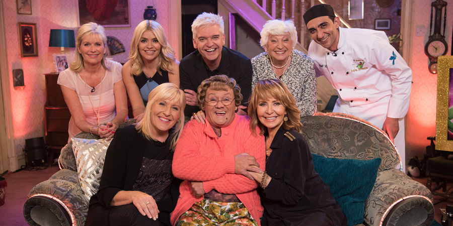 All Round To Mrs. Brown's. Image shows from L to R: Lynne Willoughby, Holly Willoughby, Cathy Brown (Jennifer Gibney), Phillip Schofield, Mrs Brown (Brendan O'Carroll), Lulu, Pat Schofield, Aly Mahmoud.