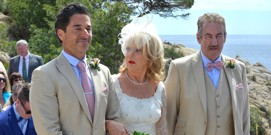 Benidorm. Image shows from L to R: Mateo (Jake Canuso), Joyce Temple Savage (Sherrie Hewson), Monty (John Challis). Copyright: Tiger Aspect Productions.