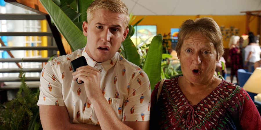 Benidorm. Image shows from L to R: Liam (Adam Gillen), Jacqueline Stewart (Janine Duvitski). Copyright: Tiger Aspect Productions.
