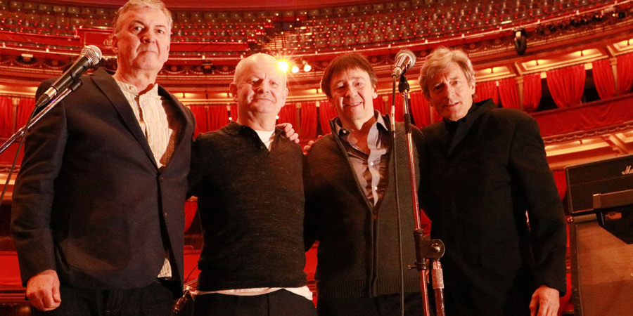 Thotch at the Royal Albert Hall for their Brian Pern tribute concert. Image shows from L to R: John (David Cummings), Mike Phillips (Philip Pope), Pat Quid (Paul Whitehouse), Tony Pebblé (Nigel Havers). Copyright: BBC.
