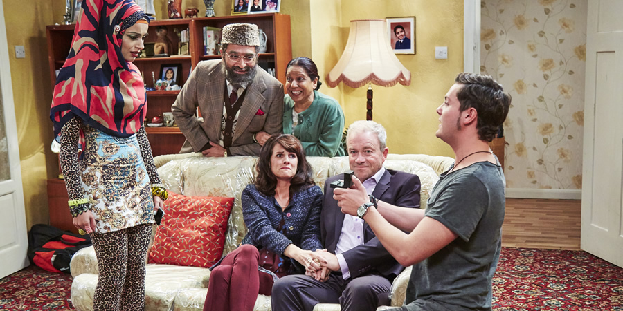 Citizen Khan. Image shows from L to R: Alia (Bhavna Limbachia), Mr Khan (Adil Ray), Suzanne (Niky Wardley), Mrs Khan (Shobu Kapoor), Andy (Harry Enfield), Scab (Tyger Drew-Honey). Copyright: BBC.