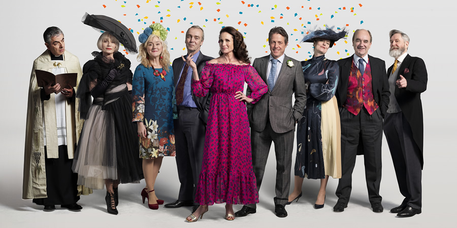 Comic Relief. Image shows from L to R: Father Gerald (Rowan Atkinson), Fiona (Kristin Scott Thomas), Lydia (Sophie Thompson), Matthew (John Hannah), Carrie (Andie MacDowell), Charles (Hugh Grant), Henrietta (Anna Chancellor), Bernard (David Haig), Tom (James Fleet). Copyright: BBC.
