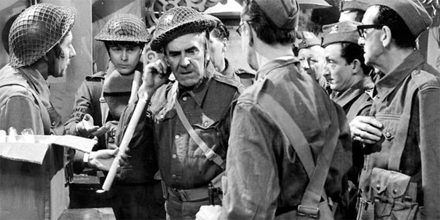 Dad's Army. Image shows from L to R: Private Walker (James Beck), Private Pike (Ian Lavender), Sergeant Wilson (John Le Mesurier), Unknown, Unknown, Unknown, Unknown. Copyright: BBC.