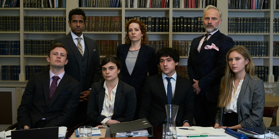 Defending The Guilty. Image shows from L to R: Liam (Hugh Coles), Ashley (Prasanna Puwanarajah), Danielle (Gwyneth Keyworth), Caroline Bratt (Katherine Parkinson), Will Packham (Will Sharpe), Miles (Mark Bonnar), Pia (Hanako Footman). Copyright: Big Talk Productions.