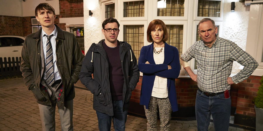 Friday Night Dinner. Image shows from L to R: Jonny (Tom Rosenthal), Adam (Simon Bird), Jackie (Tamsin Greig), Martin (Paul Ritter).