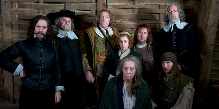 Inside No. 9. Image shows from L to R: Mr Warren (Reece Shearsmith), George Waterhouse (Trevor Cooper), Sir Andrew Pike (David Warner), Sarah Nutter (Sinead Matthews), Elizabeth Gadge (Ruth Sheen), Thomas Nutter (Jim Howick), Richard Two-Shoes (Paul Kaye), Mr Clarke (Steve Pemberton). Copyright: BBC.