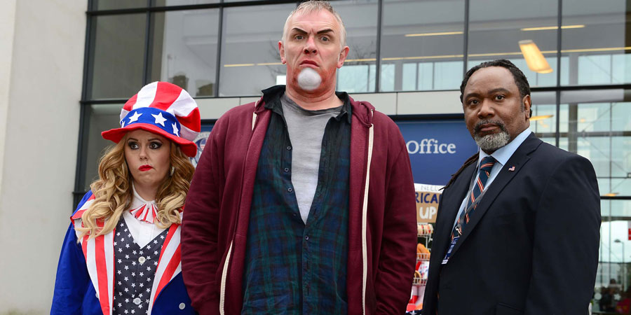 Man Down. Image shows from L to R: Jo (Roisin Conaty), Dan (Greg Davies), US Official (Reginald D Hunter). Copyright: Avalon Television.