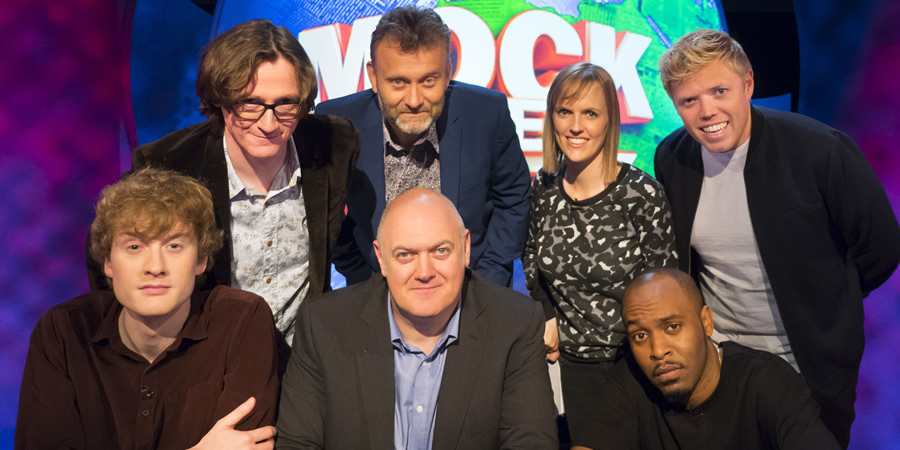 Mock The Week. Image shows from L to R: James Acaster, Ed Byrne, Hugh Dennis, Dara O Briain, Holly Walsh, Dane Baptiste, Rob Beckett.
