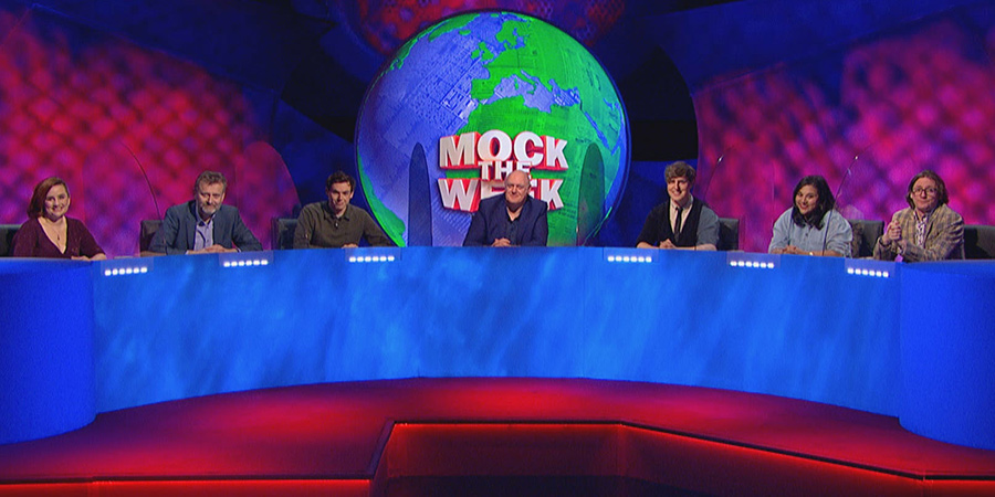 Mock The Week. Image shows from L to R: Laura Lexx, Hugh Dennis, Rhys James, Dara O Briain, Glenn Moore, Sukh Ojla, Ed Byrne. Copyright: Angst Productions.