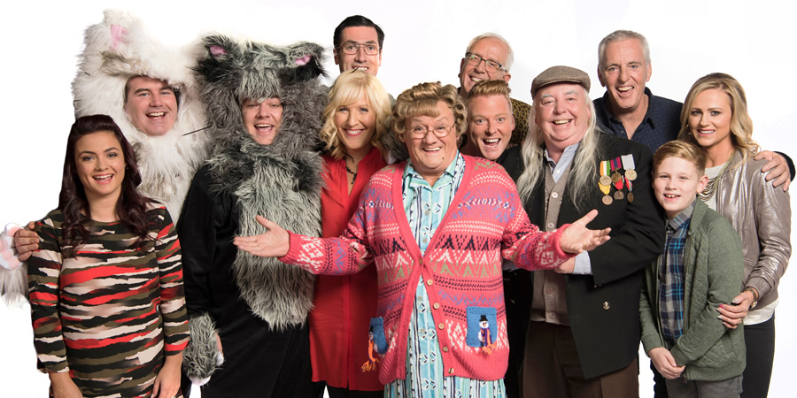 Mrs. Brown's Boys. Image shows from L to R: Maria Nicholson / Brown (Fiona O'Carroll), Dermot Brown (Paddy Houlihan), Buster Brady (Danny O'Carroll), Cathy Brown (Jennifer Gibney), Trevor Brown (Martin Delany), Dino Doyle (Gary Hollywood), Grandad Brown (Dermot O'Neill), Mark Brown (Pat Shields), Bono Brown (Jamie O'Carroll), Betty Brown (Amanda Woods).