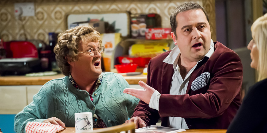 Mrs. Brown's Boys. Image shows from L to R: Agnes Brown (Brendan O'Carroll), Gaston (Robbie Telfer).