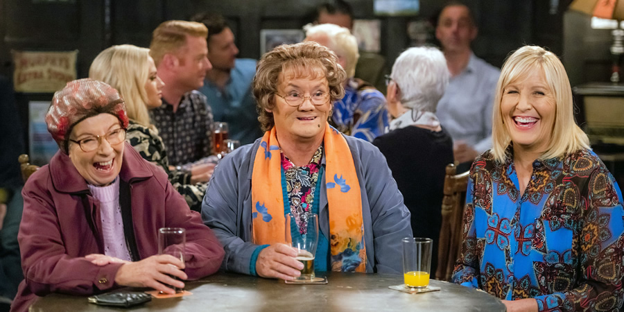 Mrs. Brown's Boys. Image shows from L to R: Winnie McGoogan (Eilish O'Carroll), Agnes Brown (Brendan O'Carroll), Cathy Brown (Jennifer Gibney).