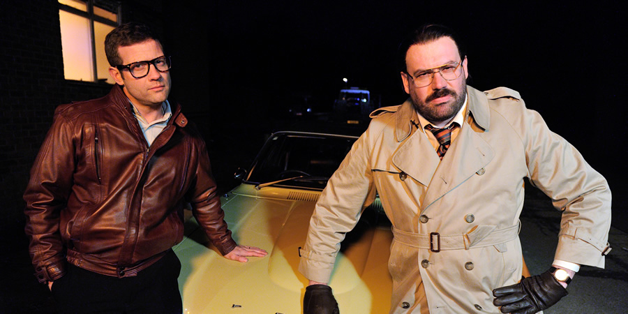 Murder In Successville. Image shows from L to R: Dermot O'Leary, DI Sleet (Tom Davis). Copyright: Tiger Aspect Productions.