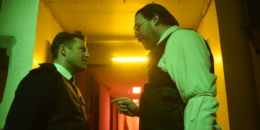 Murder In Successville. Image shows from L to R: Mark Wright, DI Sleet (Tom Davis). Copyright: Tiger Aspect Productions.