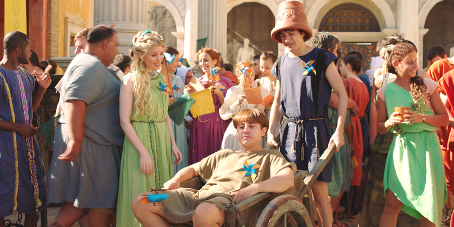 Plebs. Image shows from L to R: Diana (Rachel Parris), Grumio (Ryan Sampson), Marcus (Tom Rosenthal). Copyright: RISE Films.
