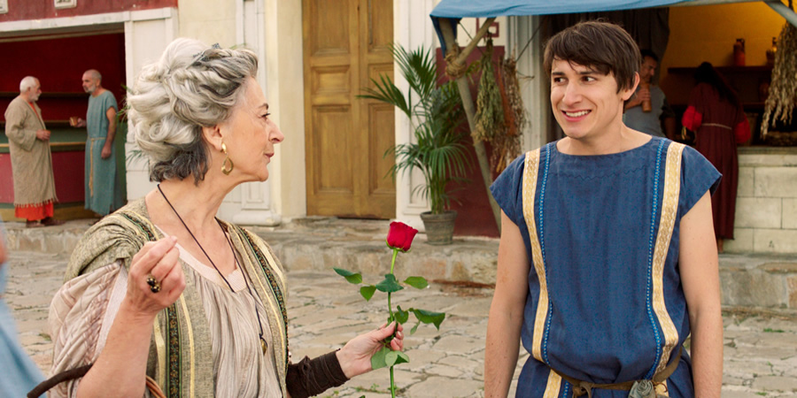 Plebs. Image shows from L to R: Landlady (Maureen Lipman), Marcus (Tom Rosenthal). Copyright: RISE Films.