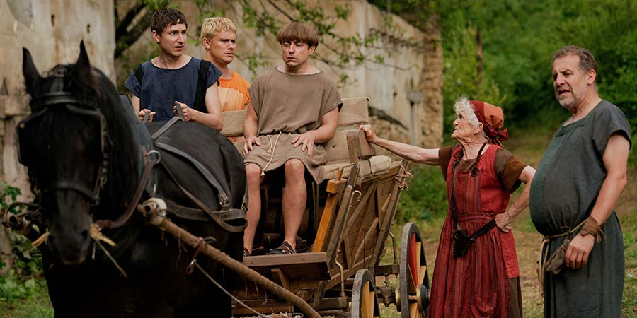 Plebs. Image shows from L to R: Marcus (Tom Rosenthal), Jason (Jon Pointing), Grumio (Ryan Sampson), Nanna (Paola Dionisotti), Atlas (Nigel Lindsay). Copyright: RISE Films.