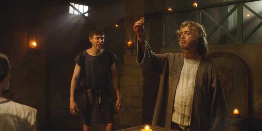 Plebs. Image shows from L to R: Marcus (Tom Rosenthal), Daedalus Greco (Tony Robinson). Copyright: RISE Films.