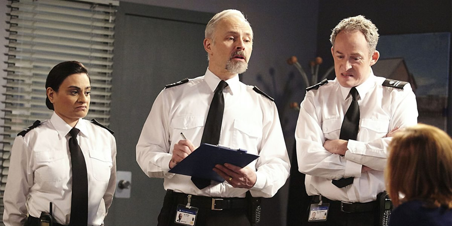 Porridge. Image shows from L to R: Officer Driscoll (Amina Zia), Officer Meekie (Mark Bonnar), Officer Braithwaite (Dominic Coleman). Copyright: BBC.