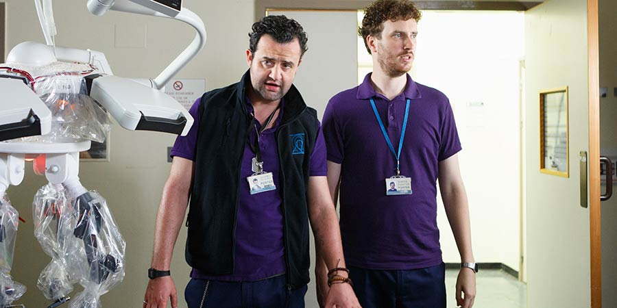 Porters. Image shows from L to R: Anthony De La Mer (Daniel Mays), Simon Porter (Edward Easton).