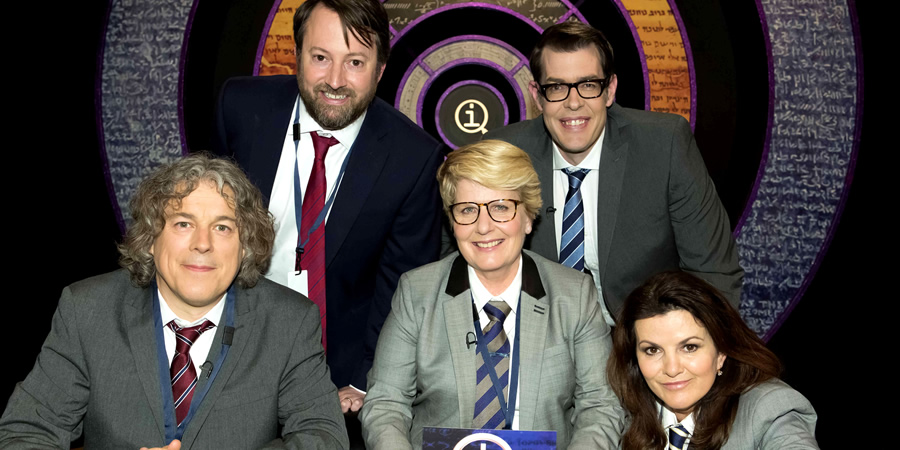 Delightful QI. Image Shows From L To R: Alan Davies, David Mitchell, Sandi