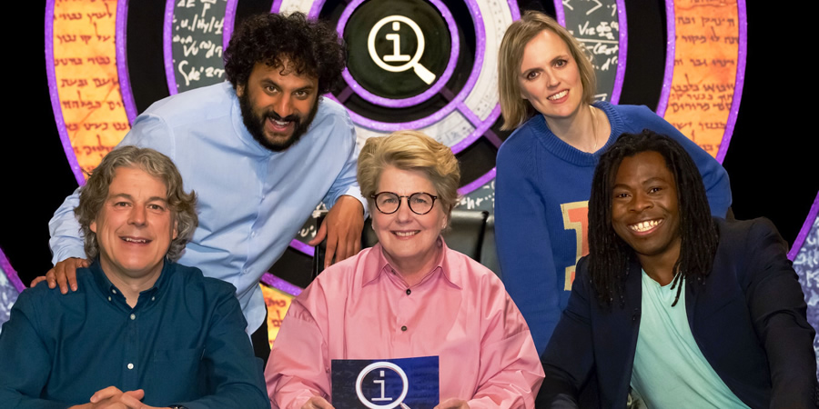 QI. Image shows from L to R: Alan Davies, Nish Kumar, Sandi Toksvig, Holly Walsh, Ade Adepitan. Copyright: TalkbackThames.