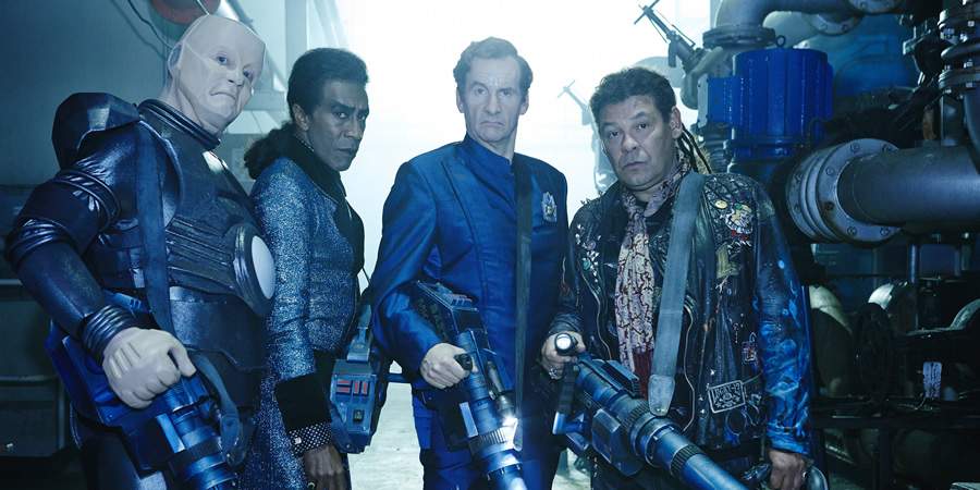 Red Dwarf. Image shows from L to R: Kryten (Robert Llewellyn), Cat (Danny John-Jules), Rimmer (Chris Barrie), Lister (Craig Charles).