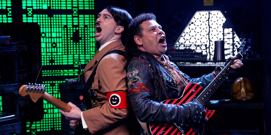 Red Dwarf. Image shows from L to R: Hitler (Ryan Gage), Lister (Craig Charles).
