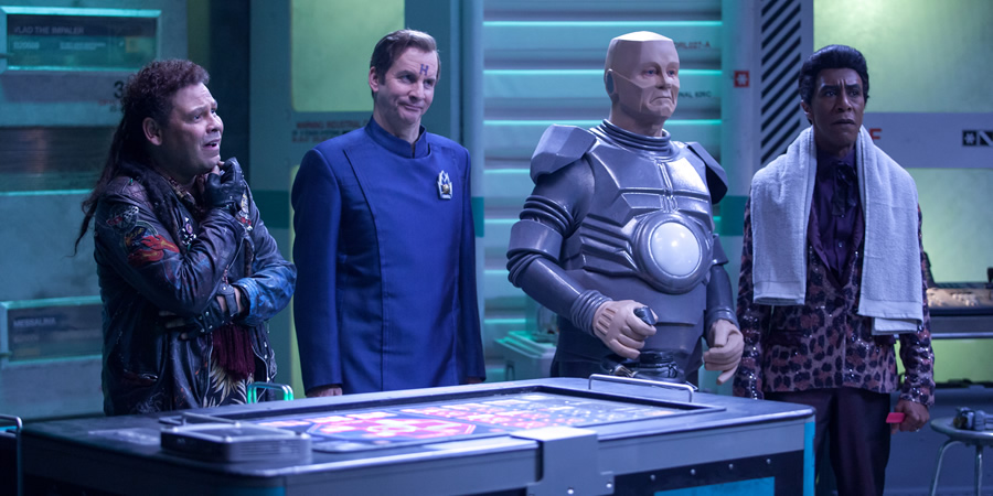 Red Dwarf. Image shows from L to R: Lister (Craig Charles), Rimmer (Chris Barrie), Kryten (Robert Llewellyn), Cat (Danny John-Jules).