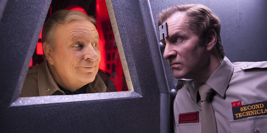 Red Dwarf. Image shows from L to R: Captain Hollister (Mac McDonald), Rimmer (Chris Barrie).